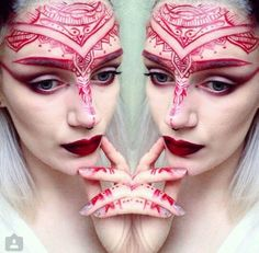 Red henna face creation. Unusual concept, execution could be finer.