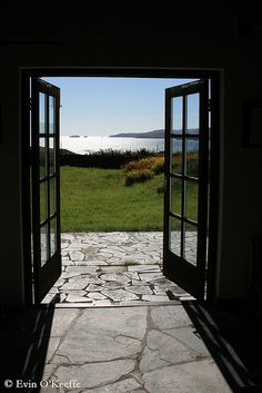 View of the water in West Cork, Ireland. I love how the double doors open up onto a grassy garden and show instant views of the ocean. Photo by @Evin O'Keeffe
