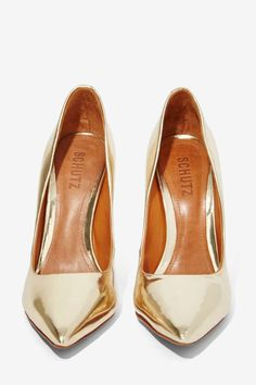 Strike gold in the Schutz Gilberta Patent Leather Pumps.