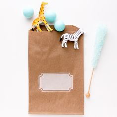 Brown kraft paper bags are printed to look like they were stamped with white ink, making a built-in name tag for the lucky recipient of this pretty bag Measurin