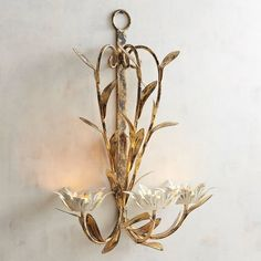 Cultivate a botanical lighting scheme with our exclusive iron wall sconce.