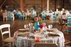 rustic wedding table rustic chairs/ mismatched chairs burlap tablecloths and lace overlays