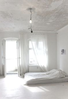 don't paint a cracking ceiling, keep it as it is, from your bed, it's a perfect cloudy sky