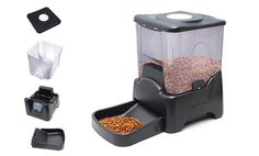 Automatic pet feeder with programmable timer, portion sizes, and feeding-time message makes feeding consistent and easy