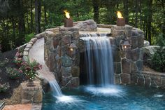 Slide and falls in pool....love it. Love the latterns and torches too.