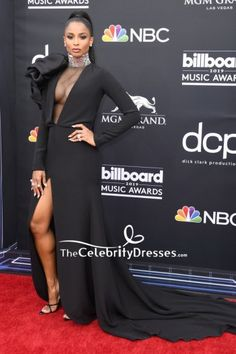 #Ciara dropped jaws in a black sleeved #eveningdress with a sheer-panel bodice, sculptural shoulder detail, and a high front slit at the #2019BillboardMusicAwards.