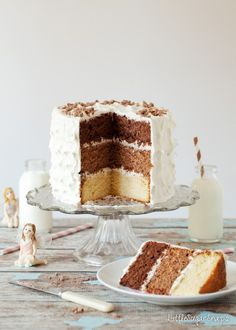 The Triple Chocolate Layer Cake combines dark, malted milk & white chocolate sponge cakes. Covered in a luscious marshmallow buttercream frosting, it is a special celebration cake Brownie Desserts, Chocolate Desserts, Fun Desserts, Chocolate Layer Dessert, White Chocolate Cake, Delicious Cake Recipes, Cupcake Recipes, Yummy Cakes, Layer Cake Recipes