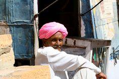 Portrait of a man wearing a pink turban, Jaisalmer, India. Photo by Jolly Sienda Photography.