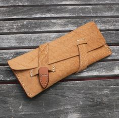 GARNY - MAKEUP POUCH - WHISKEY COLOR BUFFALO HIDE    Sophisticated - Minimalist - Functional Design.    This single pocket pouch will hold your
