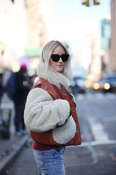 Charlotte from the @fashionguitar wearing our shearling bomber jacket from the Hilfiger Collection