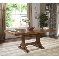 This charming dining table is the perfect addition to any dining room. Designed to seat six, but with its concealed butterfly leaf it will easily accommodate larger gatherings. The antiqued finish and distressed detailing create a warm, rustic feel.