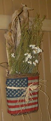 Americana Wall Pocket...with dried flowers & wrapped with a stained flag & twine.