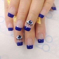 A very quirky and eye opening blue French tip design. Using clear base color, dark blue is used for the French tip. To add an interesting flair on the design, pair of googly eyes is painted on top.