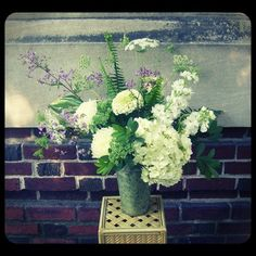 A serene mix of lavender meadow rue, ferns, hydrangea, stock, zinneas, Queen Anne's Lace and football mums.  Roberts Flowers of Hanover, Hanover, NH
