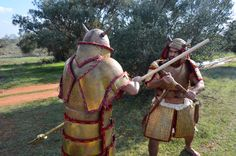 Fight between Mycaenean and Hittite warriors, utilizing a mix of weapons and armor. Reconstruction by Hellenicarmors, of Mycaenean and Hittite armors and weapons.