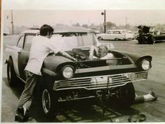57 Ford gasser ....I think that might be Edd China in the engine bay of this Ford Gasser lol