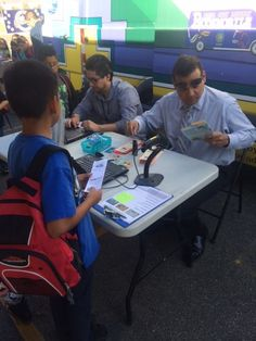 Principal Robert Allard helps check out books to his students at Paramount School!