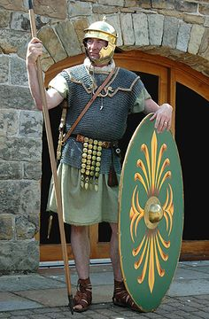 An auxiliary infantryman of the first century AD. His armour and equipment are decidedly inferior to that of the legionary. He wears a light mail shirt and a Gallic helmet. Instead of the sophisticated pilum, the throwing spear of the legionary, he carries the hasta, a more basic stabbing spear. His light shield is flat and oval, offering no corners to snag. It hence is a shield better suited to for fighting invidually, in loose formation or in difficult terrain.