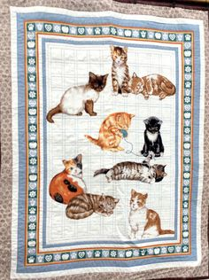 Katies Kittens fabric from a range by Rose and Hubble.  Wall hanging completed after a long, long wait. @mrstopaz