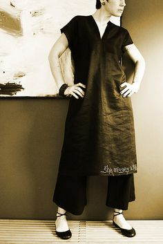 nani iro dress pattern in black linen. with embroidered 'she misses what she never had' at hemline.
