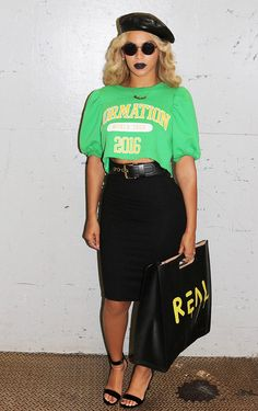 As she rounds out her Formation World Tour, Bey dons a neon green Formation T-shirt, waist-cinching belt, pencil skirt, and strappy heels. She punctuates the look with a leather beret and matching dark pout.