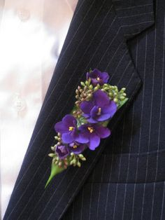 Purple boutonniere idea - African violet and seeded eucalyptus