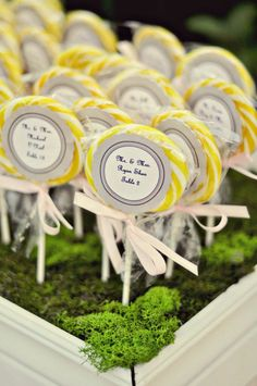 Escort card lollipops. Photography by lindseyraephoto.com, Event Floral Design by tonichandlerflorals.com, Event Design by exquisiteeventsofnewport.com