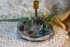 Vintage Farberware Shot Glass Set. Starting at $30