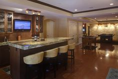 Why not turn your basement into a stylish bar where you can entertain?