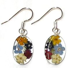 Real Flower Earrings. Oval Dangles. The flowers are real flowers grown without fertilizers or pesticides. Earrings are made through cottage industry in Taxco Mexico.  Margarito Santos and his brother started the business and with a small team of workers they grow the flowers and make the jewelry in their homes, encasing and preserving the flowers. Fair Trade!