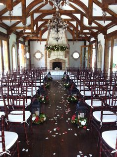 Loved this venue! We lined the aisle with lanterns and the florists wired flowers around them. The florist also created the mantle piece