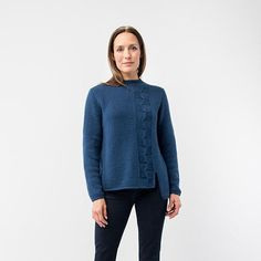 North is a unique pullover with a bold square cable offset by I-cord edges and an asymmetric hem. Drift lends vivid stitch definition and softness making this a key piece to add to your wardrobe.