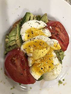 Avotoast — egg, avocado, tomatoes