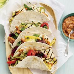 Tofu-and-Vegetable Tacos with Eggplant-Ancho Spread | Chef Alyssa Gorelick wraps grilled vegetables and tofu in tortillas with an eggplant-and-ancho-chile spread that gives the tacos a rich, smoky taste. The spread is also delicious as a dip with pita chips.
