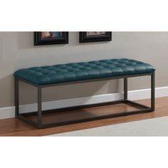 Add a stylish touch to any indoor space with this tufted leather bench from Healy. A beautiful teal upholstery and graphite grey metal frame highlights this bench.