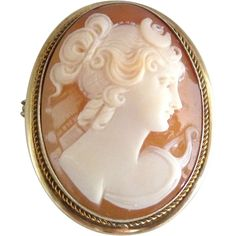 Italian Carved Shell Cameo Pendant/Brooch Depicting A Beautiful Woman With Up Swept Hair, Mounted In Sterling Silver With Gold Roping Around The Cameo Bezel    c. 1945
