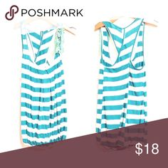 Turquoise tank Flowy turquoise and white stripe flowy top that has criss cross back Tops
