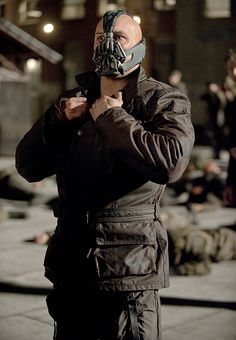 Tom hardy as Bane!  Im sorry I find this Oddly Hot.....Im sick I know but there is something about a man in power and wanting to create chaos...Im wierd I know