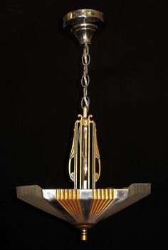 From the 1930s showing the transition from the Art Deco style to the Mid Century Moderne. Restored to their original glory including highly polished aluminum highlights and body restored to the sunset golden color. Both original ceiling canopies have their original luster back. http://www.vintagelights.com/product/1/1930s-mid-century-deco-two-shade-pendant.html