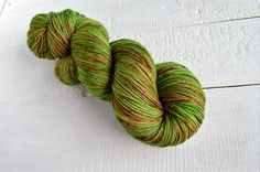 Yarn - 75% Superwash Merino 25% Nylon Weight - 100g, 4ply, Fingering Length - 400m/437yards Recommended Needle/Hook Size - 2.5mm-3.5mm Colourway - Various shades of green throughout yarn with red/brown highlights