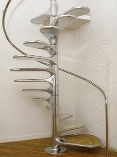 Roger Tallon's helicoid spiral staircase - this is the railing ours should have had. That would have been outstanding.