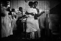 "Segregation African Americans dancing to jukebox music in ""Harlem Cafe,"" Greenville, South Carolina. Location:Greenville, SC, US Date taken:1956 Photographer:Margaret Bourke-White"