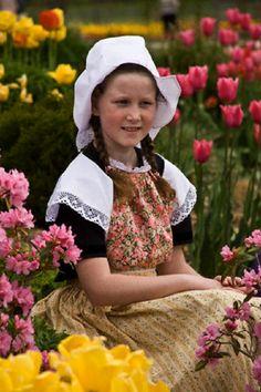 Girl in Dutch costume at the annual Tulip Time Festival in Holland, Michigan