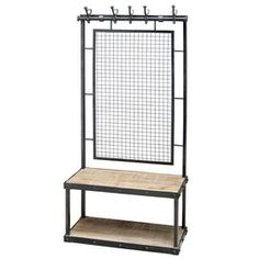 A steel framed unit painted black.Wooden bench and under shelf.Five cast iron hooks with random steel numbers, featuring a wire mesh back. Pipe Furniture, Steel Furniture, Industrial Furniture, Furniture Design, Furniture Removal, Vintage Shelving, Interior Design Living Room, Interior Livingroom, Kitchen Interior