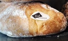 Traditional italian bread with a golden brown floured crust, a moist interior and large airy holes