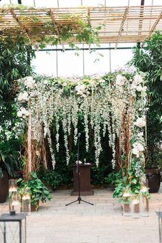 wedding ceremony flowers - photo by Kelly Sweet http://ruffledblog.com/20-ceremony-backdrops-for-tears-of-joy/