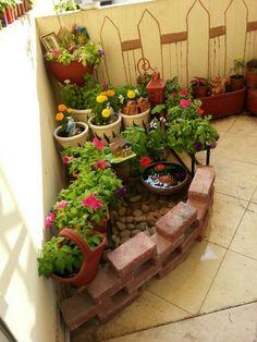 Bricks n.pebbles add beauty to balcony.