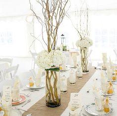 White hydrangea and branch arrangement