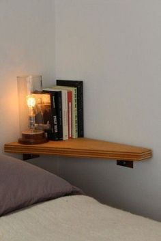 "Instead of a nightstand, install a wall shelf at appropriate height! I made a fold down ""wall desk"" and I love how much less space it takes up. This would be easy and perfect to put in a home!"