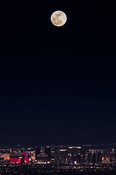 city lights under the moon